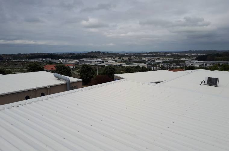 A view of the sea from on top of a clean roof