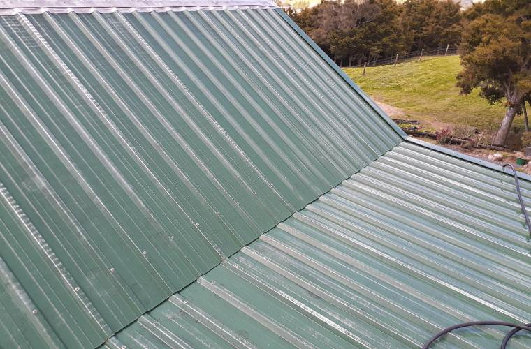 A green corrugated iron roof after being cleaned