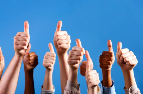 A bunch of people giving the thumbs up